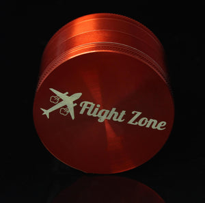 63mm Grinder - Flight Zone  Material: Metal Size: 63mm Color: Various Colors Features: 4 Chamber Scooper Included Laser-etched Flight Zone Logo
