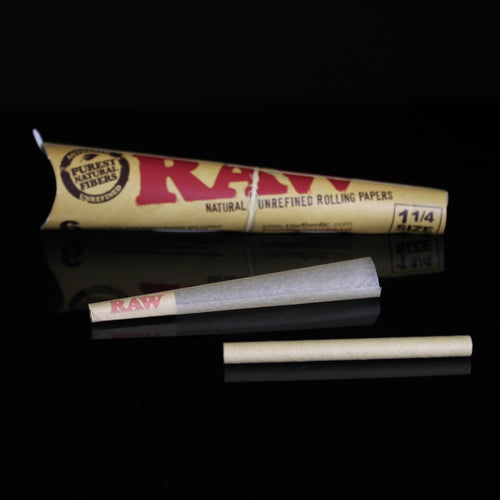 RAW Cones - Flight Zone Brand: RAW  Material: Organic Hemp Paper Size: 1 1/4 Color: N/A Features:  Natural Unrefined Rolling Paper Pre-rolled Cones Authentic 6 Cones Per Pack