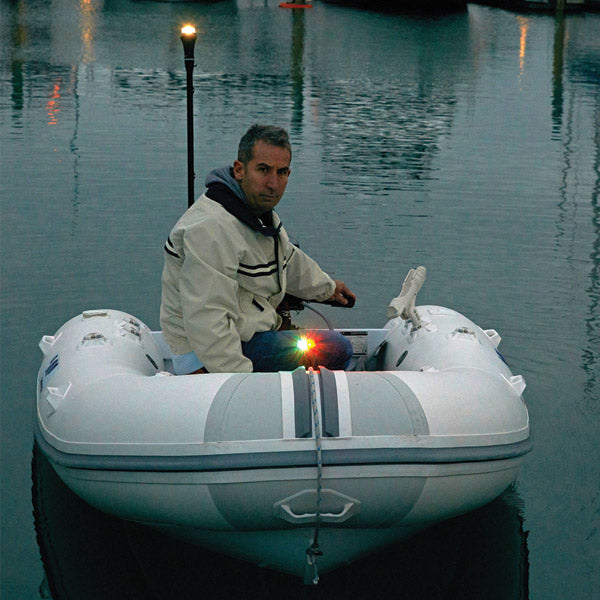 a man sitting on a boat in the water