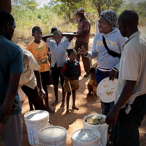 Zambian beekeepers and children
