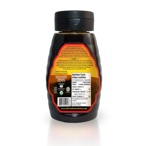 Back view of African Summer Harvest forest honey in a 500g squeeze bottle