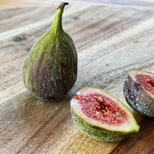 Load image into Gallery viewer, fresh figs, one cut open on a wooden board