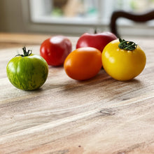 Load image into Gallery viewer, collection of Heirloom tomatoes on a wooden board