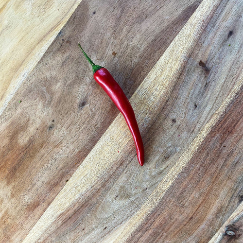 fresh red chilli on a wooden board