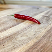 Load image into Gallery viewer, fresh red chilli on a wooden board