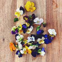Load image into Gallery viewer, edible viola flowers on a wooden board
