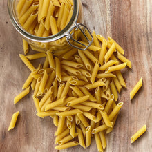 Load image into Gallery viewer, penne pasta on a wooden board with a jar of penne above