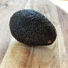 Load image into Gallery viewer, ripe hass avocado on a wooden board