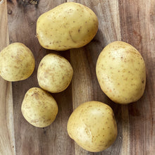 Load image into Gallery viewer, 6 loose potatoes on a wooden board