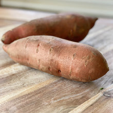 Load image into Gallery viewer, 2 sweet potatoes on a wooden board