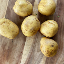 Load image into Gallery viewer, 6 large potatoes on a wooden board