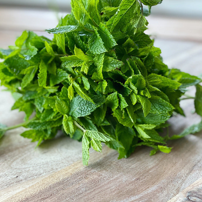 bunch of fresh mint on a wooden board