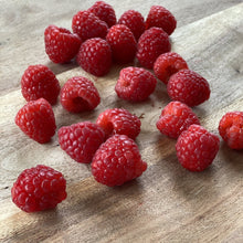 Load image into Gallery viewer, fresh raspberries on a wooden board