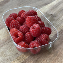 Load image into Gallery viewer, punnet of fresh raspberries on a wooden board
