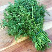 Load image into Gallery viewer, fresh bunch of dill on a wooden board