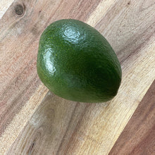 Load image into Gallery viewer, green avocado on a wooden board