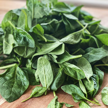 Load image into Gallery viewer, fresh baby spinach on a wooden board