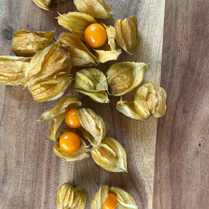 physalis on a wooden board