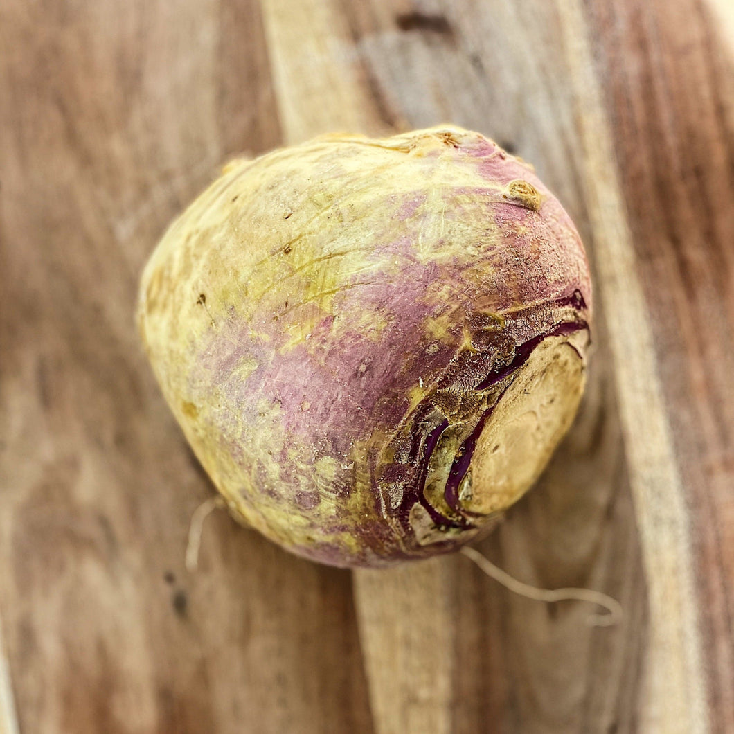 raw swede on a wooden board