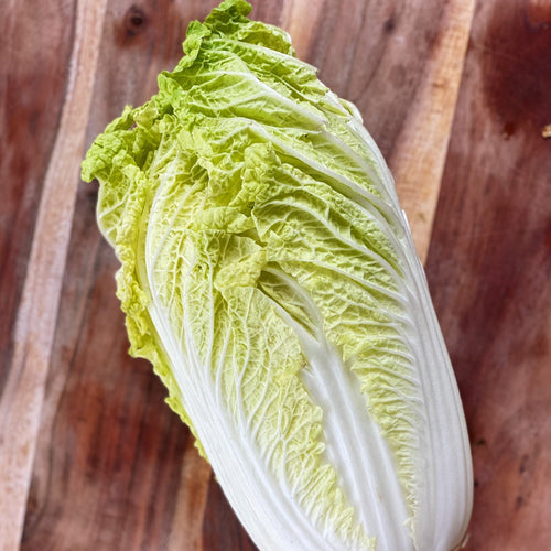 chinese leaf lettuce on a wooden  board