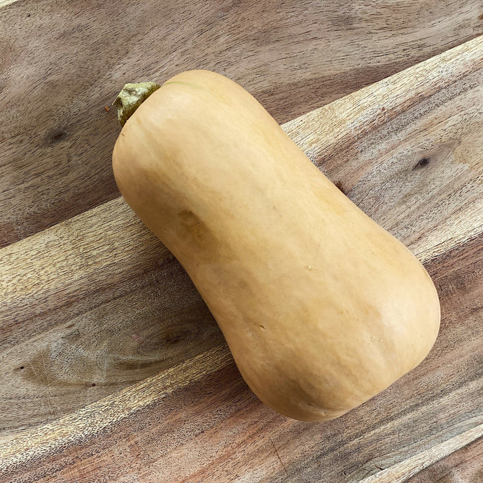 butternut squash on a wooden board