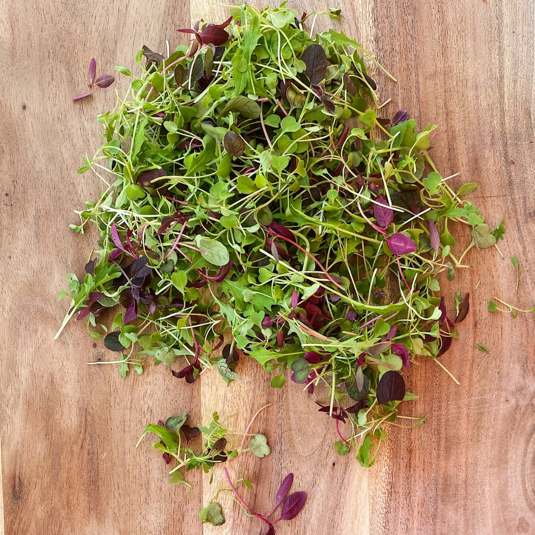 micro salad leaves on a wooden board