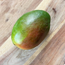 Load image into Gallery viewer, fresh mango on a wooden board