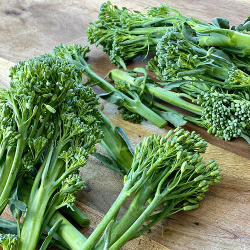 tenderstem brocolli on a wooden board