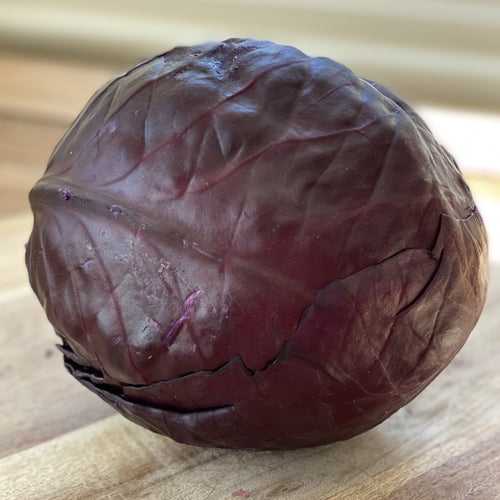 purple red cabbage on a wooden board