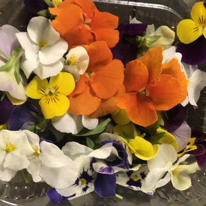edible viola flowers in a punnet
