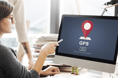 Woman checking GPS location on computer