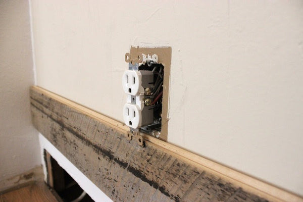 Reclaimed Wall Paneling Around Wall Outlet