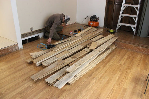 Reclaimed Wood Wall Planks Being Installed