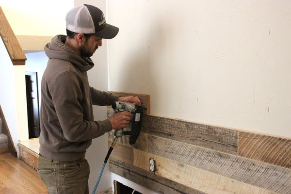 Man Installing Reclaimed Wood Tongue & Groove Wall Planks