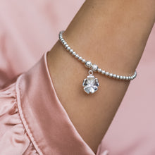 Load image into Gallery viewer, Dazzling 925 sterling silver stretch bracelet with cute flower charm