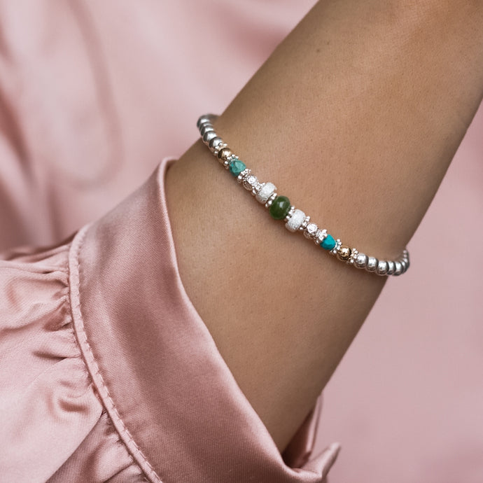 Oriental 925 sterling silver stretch bracelet with 14K gold filled beads and Turquoise gemstone
