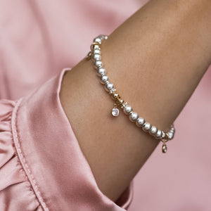 Elegant sterling silver stacking bracelet with 14k gold filled beads and Cubic Zirconia charms