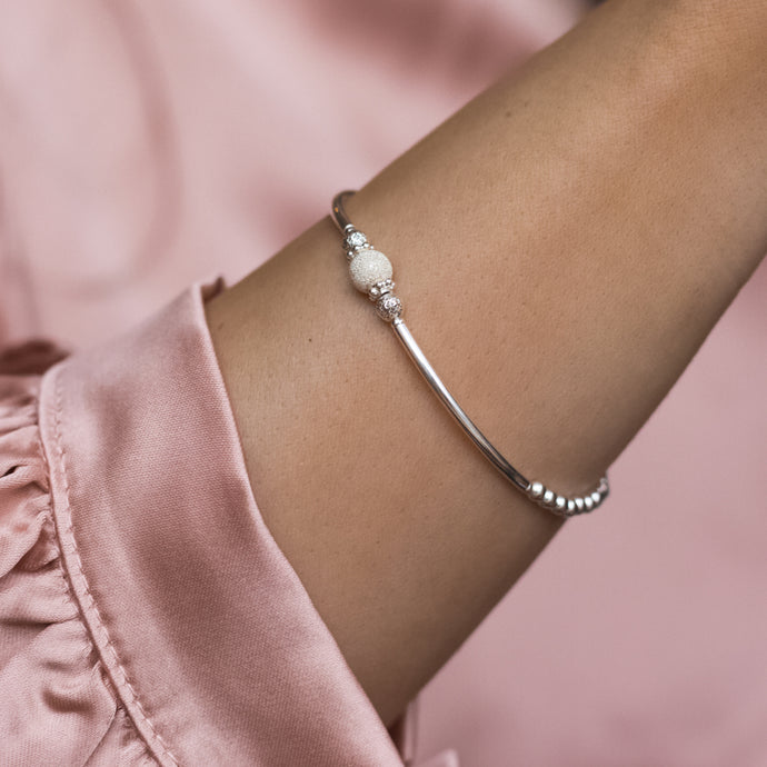 Elegant 925 sterling silver stacking bracelet with beautiful frosted ball