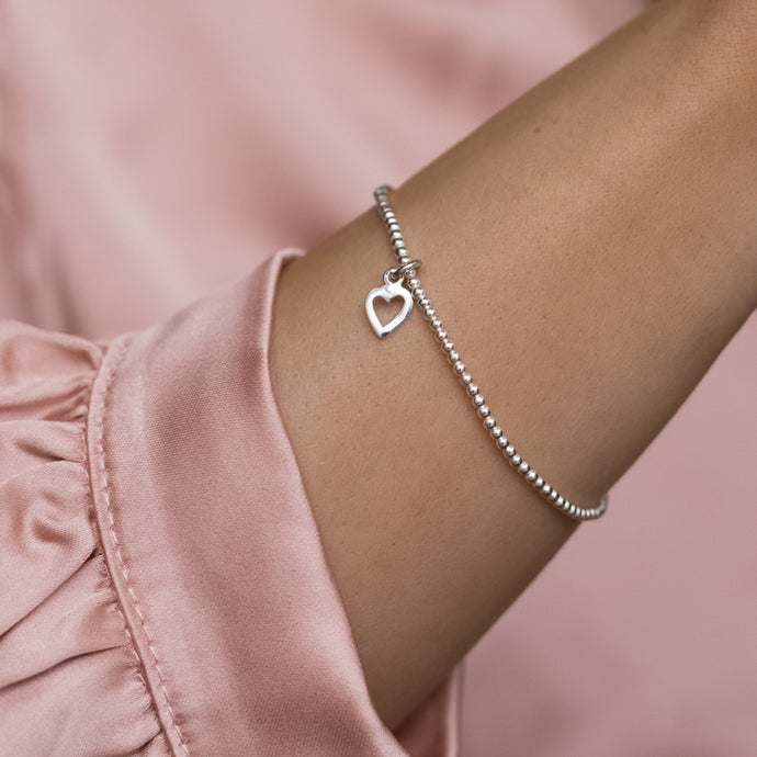 Minimalist 925 sterling silver elastic/stretch bracelet with adorable tiny Heart charm