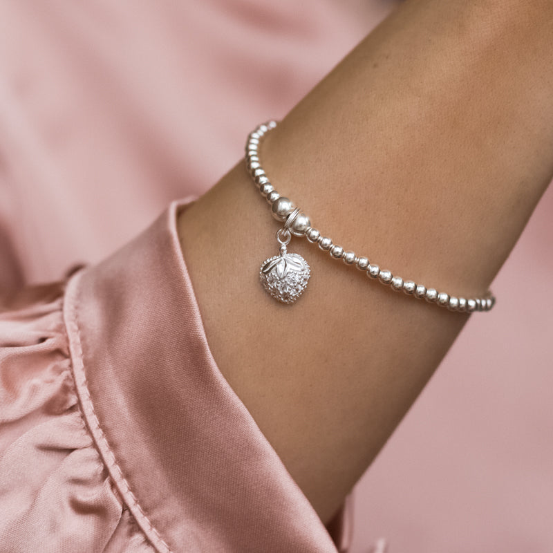 Gorgeous 925 sterling silver stretch bracelet with strawberry charm and Cubic Zirconia stones