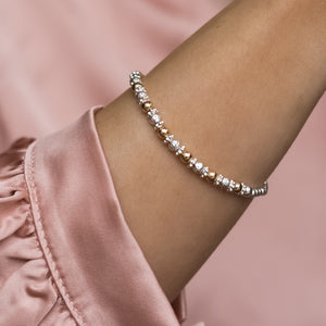 Elegant 925 sterling silver and 14k gold filled stretch bracelet with dazzling multicut silver beads
