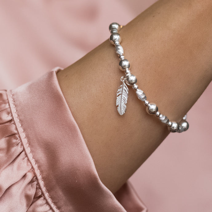 Luxury 925 sterling silver stacking bracelet with Feather charm