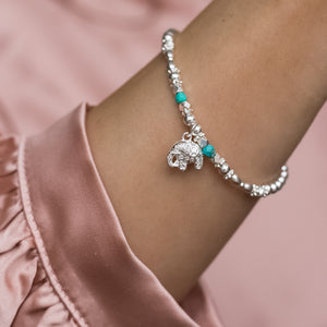 Oriental 925 sterling silver stretch stacking bracelet with Elephant charm and Turquoise gemstone
