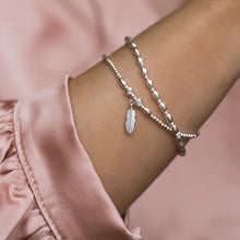Load image into Gallery viewer, Minimalist 925 sterling silver bracelet stack with Feather charm