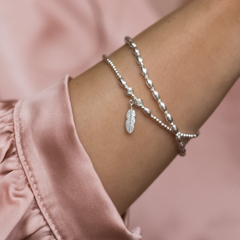 Minimalist 925 sterling silver bracelet stack with Feather charm