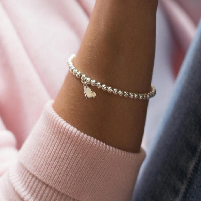 Lovely 925 Sterling silver ball elastic/stretch stacking bracelet with silver heart charm