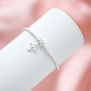 Fashionable 925 sterling silver stretch bracelet with cross charm