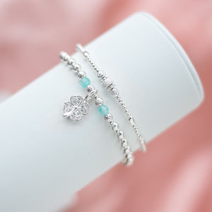 Sparkling 925 sterling silver stack with a Four-leaf clover charm and Aquamarine gemstone