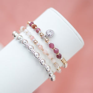Exclusive 925 sterling silver and 14k gold bracelet stack with AAA quality Pink Tourmaline and Opal gemstones