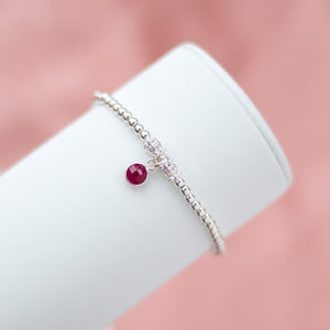 Elegantly minimalist 925 sterling silver ball bracelet with Ruby gemstone charm